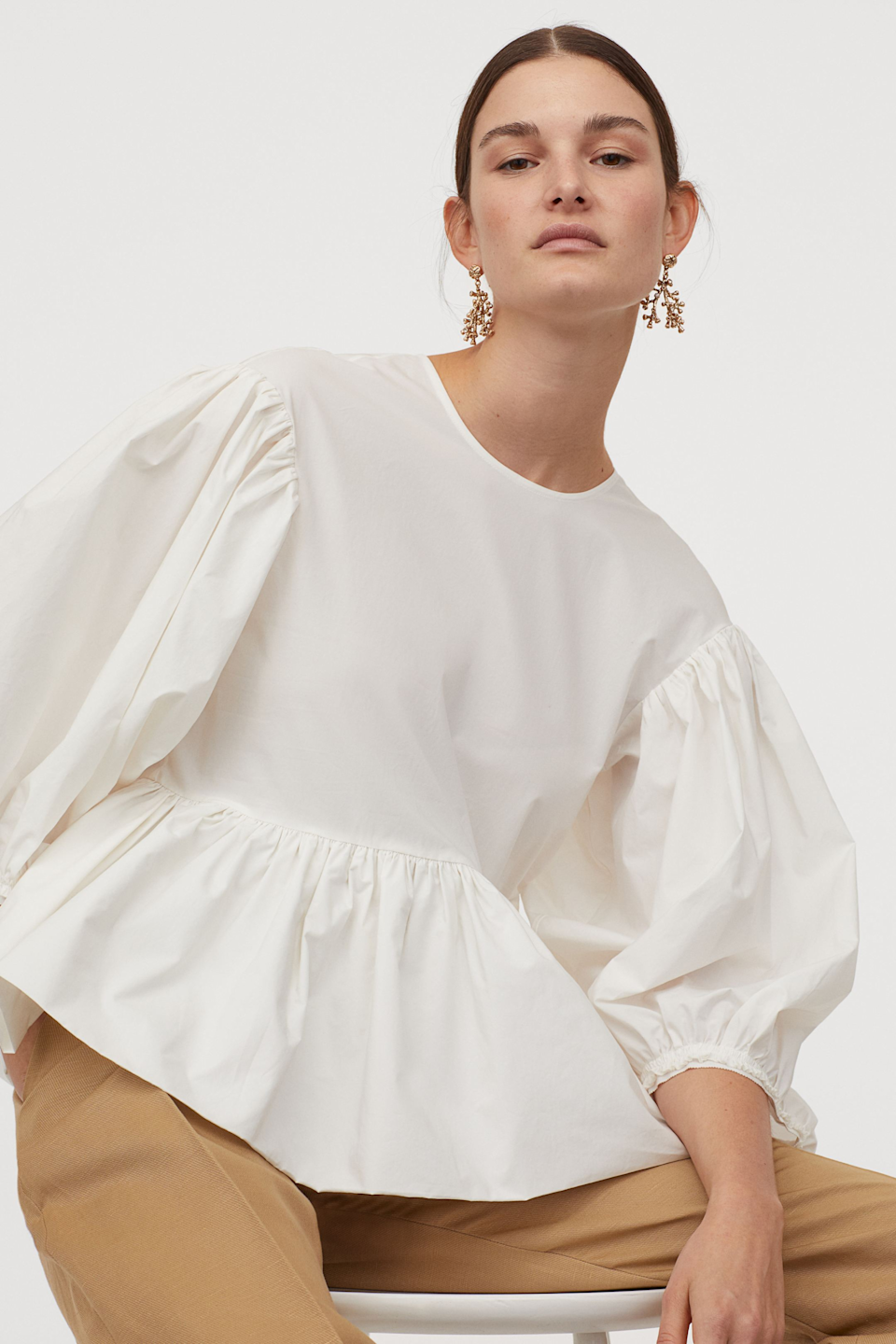 "Not only will your mom look 10/10 in this white, puff-sleeved blouse, she can also rest easy knowing that it's 100% cotton and part of H&M's Conscious Exclusive collection. <br> <br> <strong>H&M</strong> Cotton Balloon-Sleeved Blouse, $, available at <a href=""https://go.skimresources.com/?id=30283X879131&url=https%3A%2F%2Fwww2.hm.com%2Fen_us%2Fproductpage.0870956001.html"" rel=""nofollow noopener"" target=""_blank"" data-ylk=""slk:H&M"" class=""link rapid-noclick-resp"">H&M</a>"