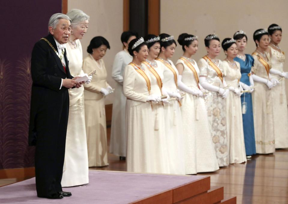 Japanese Emperor Akihito, left, accompanied by Empress Michiko, second from left, delivers a speech during an imperial ceremony in the celebration of New Year at the Imperial Palace in Tokyo, Tuesday. Jan. 1, 2019. (Kyodo News via AP)