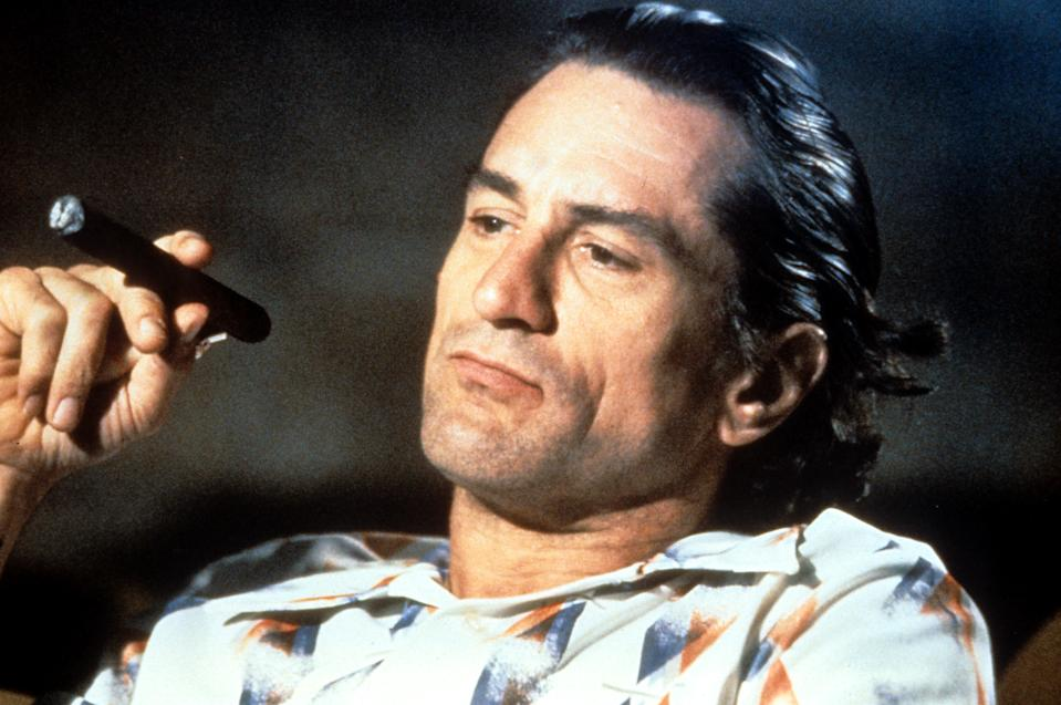 Robert De Niro smokes a cigar in a scene from the film  'Cape Fear', 1991. (Photo by Universal/Getty Images)