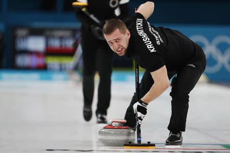 Curling – Pyeongchang 2018 Winter Olympics – Mixed Doubles Bronze Medal Match - Olympic Athletes from Russia v Norway - Gangneung Curling Center - Gangneung, South Korea – February 13, 2018 - Alexander Krushelnitsky, an Olympic athlete from Russia, sweeps. REUTERS/Cathal McNaughton