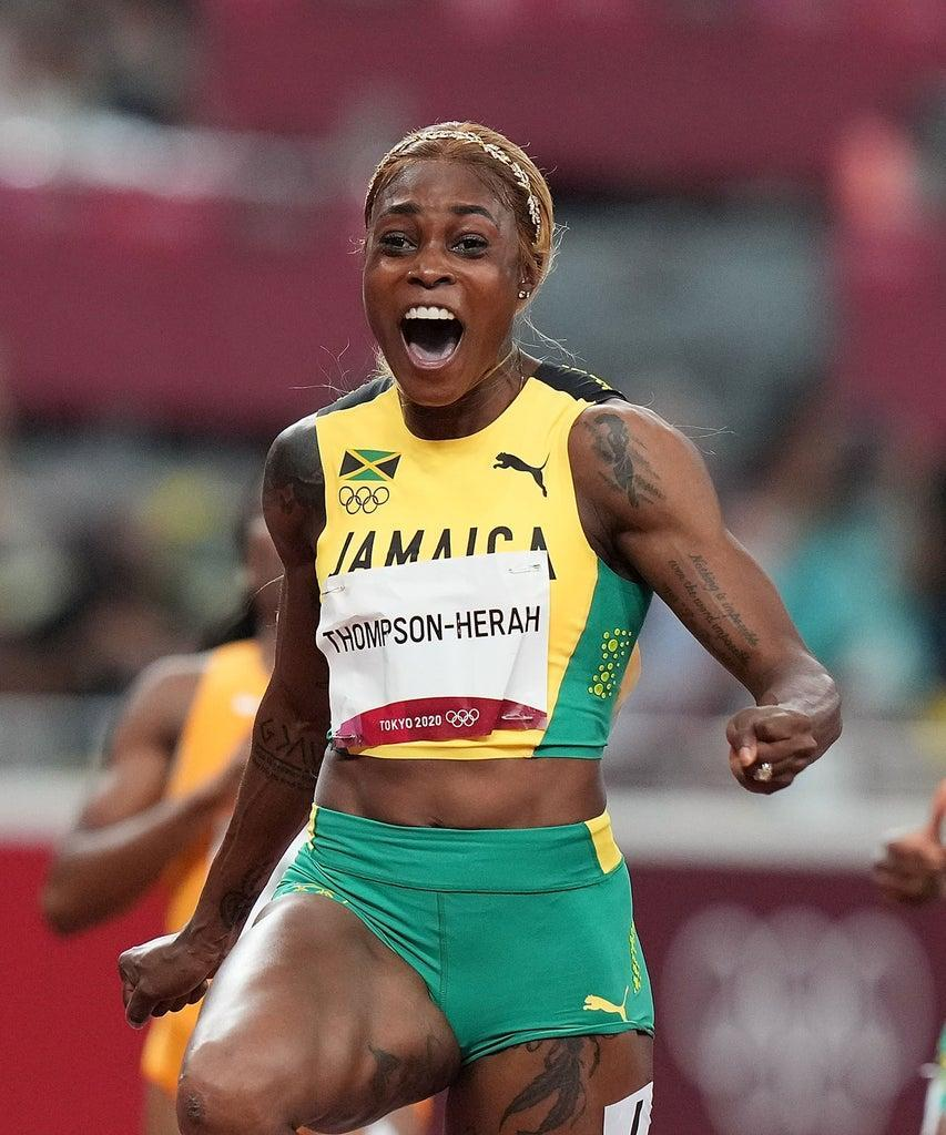 Elaine Thompson-Herah of Jamaica reacts during the Women's 100m Final at the Tokyo 2020 Olympic Games in Tokyo, Japan, July 31, 2021. (Photo by Lui Siu Wai/Xinhua via Getty Images)