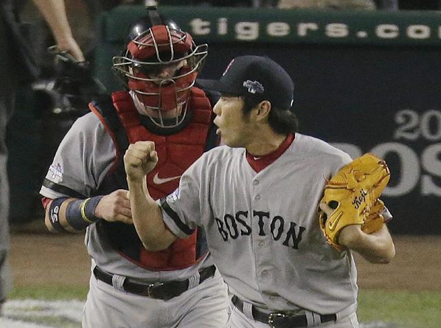 Boston Red Sox's Koji Uehara celebrates after the Red Sox defeated the Detroit Tigers 1-0 in Game 3 of the American League baseball championship series Tuesday, Oct. 15, 2013, in Detroit. (AP Photo/Charlie Riedel)