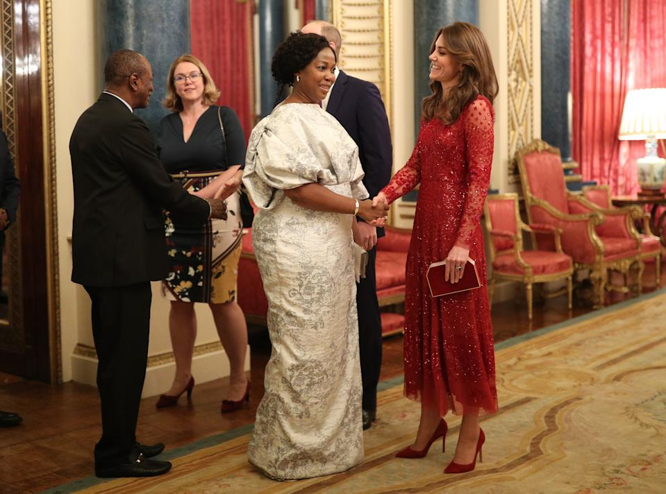 The Duchess of Cambridge paired the red dress with matching accessories. [Photo: PA]