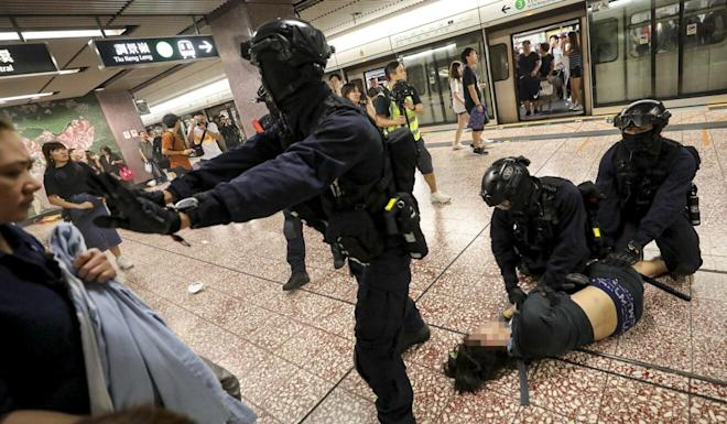 Police officers from the Special Tactical Squad stormed into Prince Edward station last August 31. Photo: Handout