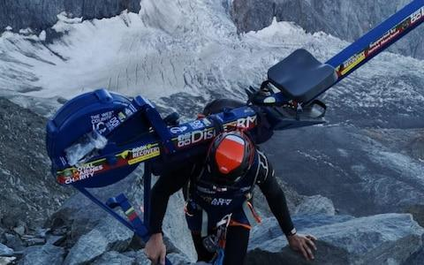 Matthew Paul Disney attempting to scale Mont Blanc with a rowing machine on his back - Credit: Telegraph