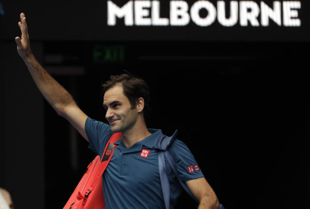 Switzerland's Roger Federer waves as he leaves Rod Laver Arena after defeating Britain's Daniel Evans in their second round match at the Australian Open tennis championships in Melbourne, Australia, Wednesday, Jan. 16, 2019. (AP Photo/Mark Schiefelbein)
