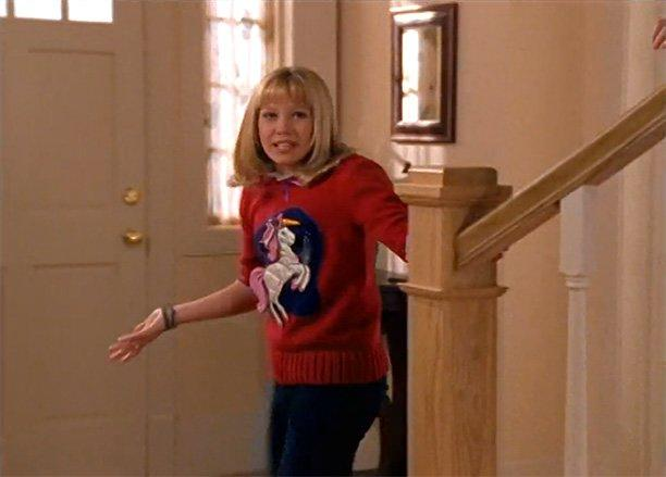 Lizzie gets off to a rough sartorial start in the series' second episode, in which Mrs. McGuire orders our protagonist to wear this nightmarish unicorn sweater from Gammy McGuire for school picture day. Not pictured: the blouse she borrowed from the drama club that got splattered with green paint when she protected Miranda from Kate's attempted outfit sabotage. Friendship is always the best look!