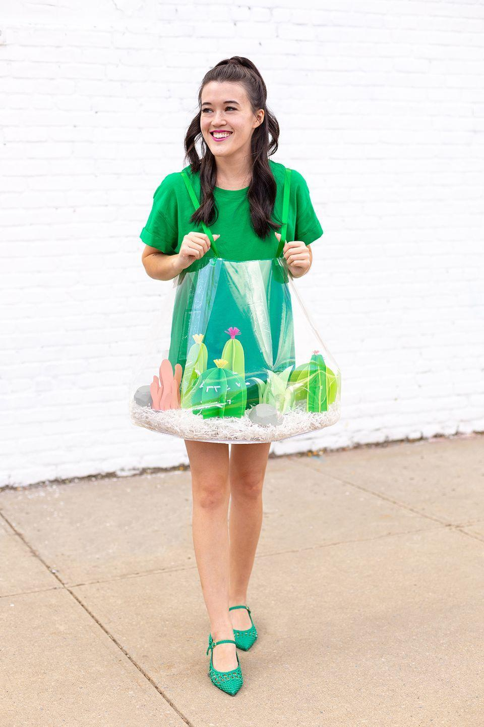 """<p>Show off your green thumb and your crafting skills all at once with this creative plant-inspired getup. </p><p><a class=""""link rapid-noclick-resp"""" href=""""http://www.awwsam.com/2018/10/diy-terrarium-halloween-costume.html"""" rel=""""nofollow noopener"""" target=""""_blank"""" data-ylk=""""slk:GET THE TUTORIAL"""">GET THE TUTORIAL</a></p><p><a class=""""link rapid-noclick-resp"""" href=""""http://www.amazon.com/Amazon-Brand-Ritual-Ballet-Back-T-Shirt/dp/B07YG34V46?tag=syn-yahoo-20&ascsubtag=%5Bartid%7C10072.g.33547559%5Bsrc%7Cyahoo-us"""" rel=""""nofollow noopener"""" target=""""_blank"""" data-ylk=""""slk:SHOP GREEN DRESS"""">SHOP GREEN DRESS</a></p>"""
