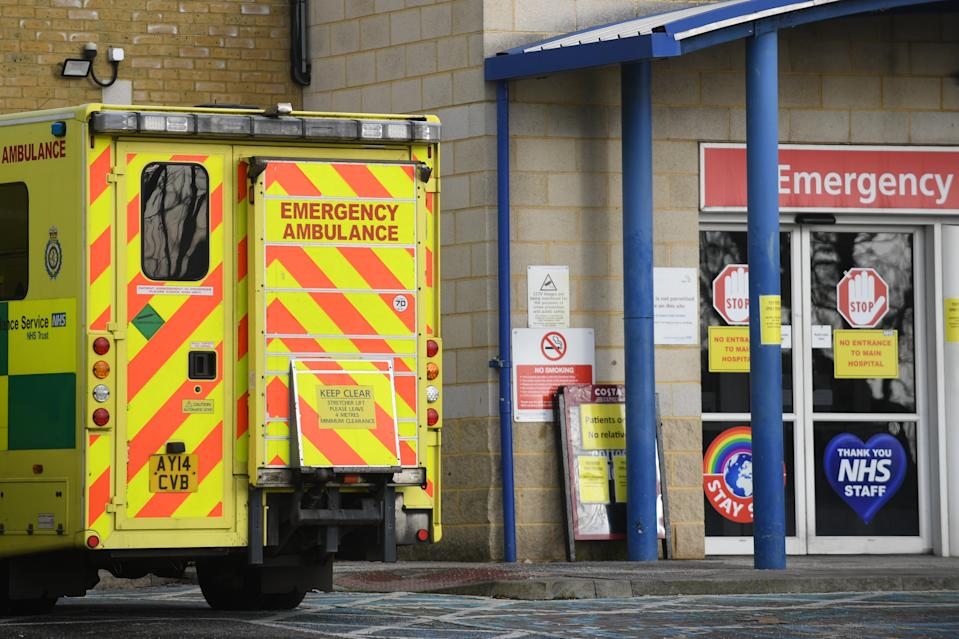 An ambulance outside an entrance to Southend University hospital in Essex. Hospitals in the county have declared a major incident and local authorities, concerned about the number of Covid-19 cases, have asked for military help to increase hospital capacity, with fears over critical care, bed capacity and staff sickness. (Photo by Joe Giddens/PA Images via Getty Images)