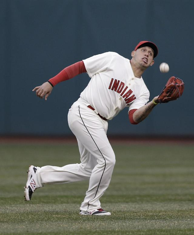 Cleveland Indians' Asdrubal Cabrera catches a fly ball hit by Minnesota Twins' Aaron Hicks during the fourth inning of a baseball game, Friday, April 4, 2014, in Cleveland. (AP Photo/Tony Dejak)