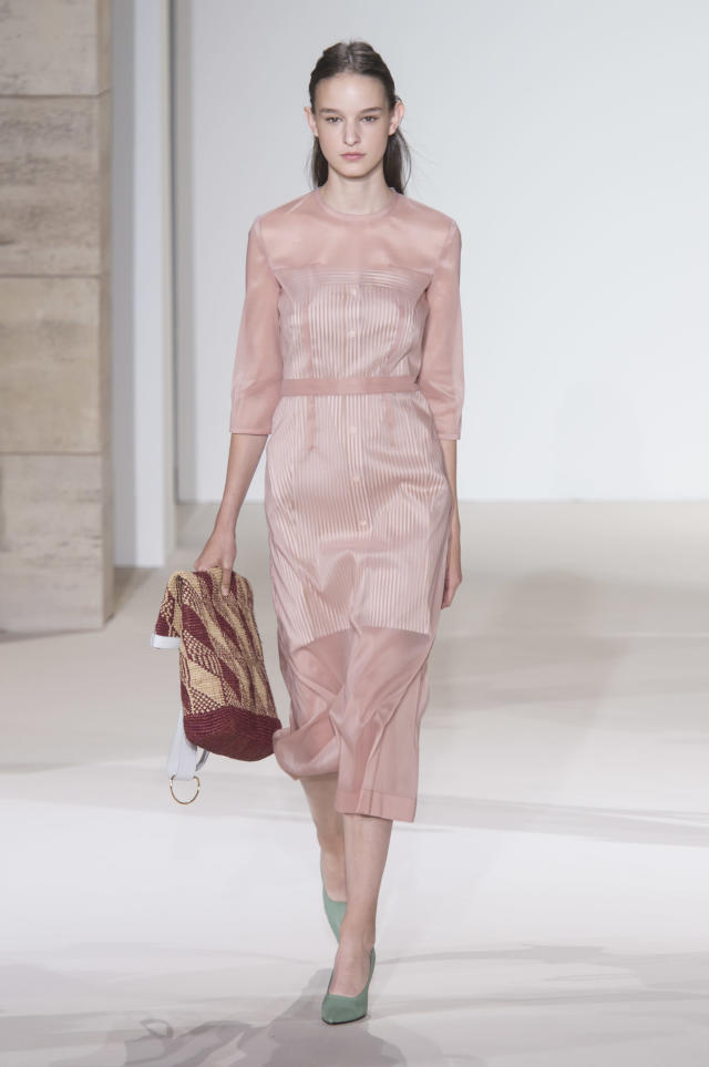 <p><i>Model wears a semi-sheer pink dress from the SS18 Victoria Beckham collection. (Photo: ImaxTree) </i></p>