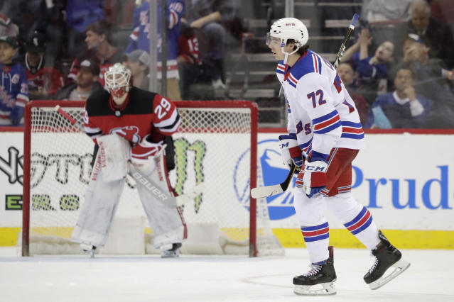 New York Rangers center Filip Chytil (72), of the Czech Republic, skates by New Jersey Devils goaltender MacKenzie Blackwood (29) after scoring a goal during the second period of an NHL hockey game, Monday, April 1, 2019, in Newark, N.J. (AP Photo/Julio Cortez)