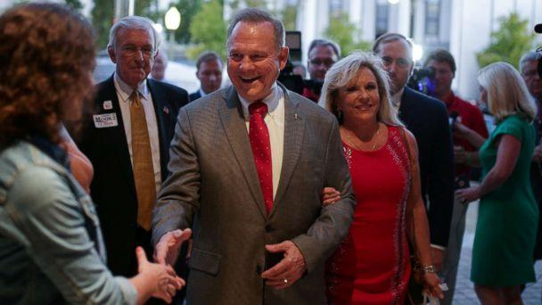PHOTO: Republican candidate Roy Moore and his wife Kayla are greeted at the door as they arrive at the RSA Activity Center in Montgomery, Alabama, September 26, 2017, during the runoff election for the Republican nomination for Alabama's U.S. Senate seat. (Marvin Gentry/REUTERS)