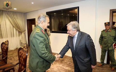 A handout photo made available by Libyan Army Media office on 05 April 2019 shows Secretary General of the United Nations Antonio Guterres (R) shaking hands with commander of the Libyan National Army (LNA) Khalifa Haftar (L) in Benghazi, eastern Libya - Credit: LIBYAN ARMY MEDIA OFFICE HANDOUT/EPA-EFE/REX