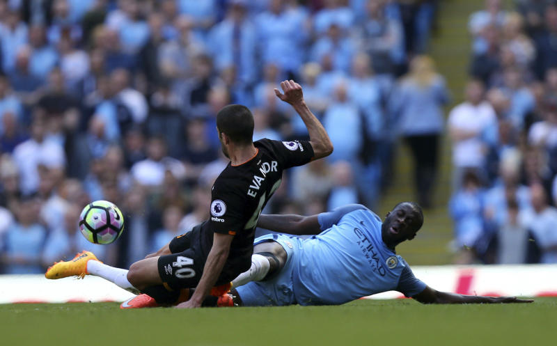 Manchester City's Yaya Toure, right, challenges Hull City's Evandro Goebel during their English Premier League match at the Etihad Stadium, Manchester, England, Saturday, April 8, 2017. (Dave Thompson/PA via AP)