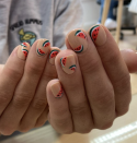 <p>A Fourth of July barbecue wouldn't be complete without a few slices of watermelon to munch on. Add the summery fruit to your nails for a manicure that you can wear on the Fourth and beyond.</p>