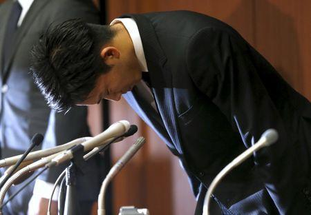 Japanese badminton player Kento Momota bows deeply at a news conference after reports on his gambling at an illegal casino in Tokyo, Japan, April 8, 2016. REUTERS/Issei Kato Picture Supplied by Action Images