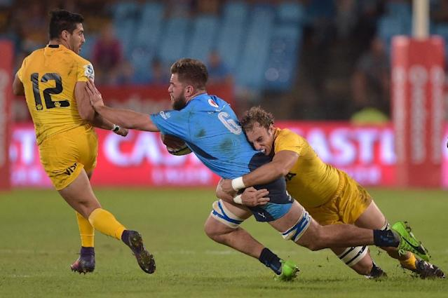Nick de Jager of the Bulls (L) is tackled by Emiliano Boffelli of the Jaguares during the Super XV rugby match between South African Bulls and Argentinian Jaguares April 15, 2017 in Pretoria (AFP Photo/CHRISTIAAN KOTZE)