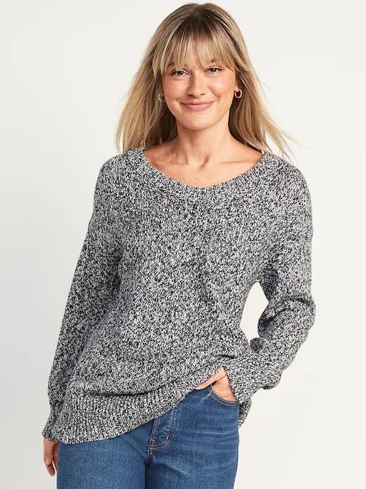 <p>Picture yourself relaxing in this ribbed <span>Old Navy Oversized Marled Voop-Neck Tunic Sweater</span> ($35) and a steamy cup of hot cocoa this September.</p>