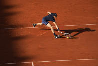 Italy's Jannik Sinner plays a return to Spain's Rafael Nadal during their fourth round match on day 9, of the French Open tennis tournament at Roland Garros in Paris, France, Monday, June 7, 2021. (AP Photo/Michel Euler)