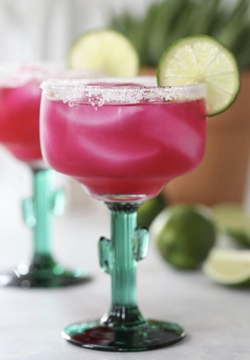 """<p>Add a little edge to your cocktail selection when you learn how to perfect this prickly pear margarita. The bright-pink-and-purple hue makes it even more fun to enjoy! Pair this with a green and yellow cocktail to bring the colors of Mardi Gras to life.</p> <p><strong>Get the recipe</strong>: <a href=""""https://inspiredbycharm.com/prickly-pear-margarita/"""" class=""""link rapid-noclick-resp"""" rel=""""nofollow noopener"""" target=""""_blank"""" data-ylk=""""slk:prickly pear margarita"""">prickly pear margarita</a></p>"""