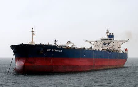 The oil tanker SCF Byrranga, which was renamed the United Kalavryta in March 2014 (also known as United Kalavrvta) and is currently off the coast of Texas with a cargo of Kurdish crude oil, is seen off the Isle of Arran, Scotland in this handout photo taken February 21, 2014. REUTERS/Tom Duncan/Handout via Reuters