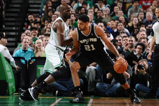 BOSTON, MA - FEBRUARY 12: Tim Duncan #21 of the San Antonio Spurs handles the ball against Joel Anthony #50 of the Boston Celtics on February 12, 2014 at the TD Garden in Boston, Massachusetts. (Photo by Brian Babineau/NBAE via Getty Images)