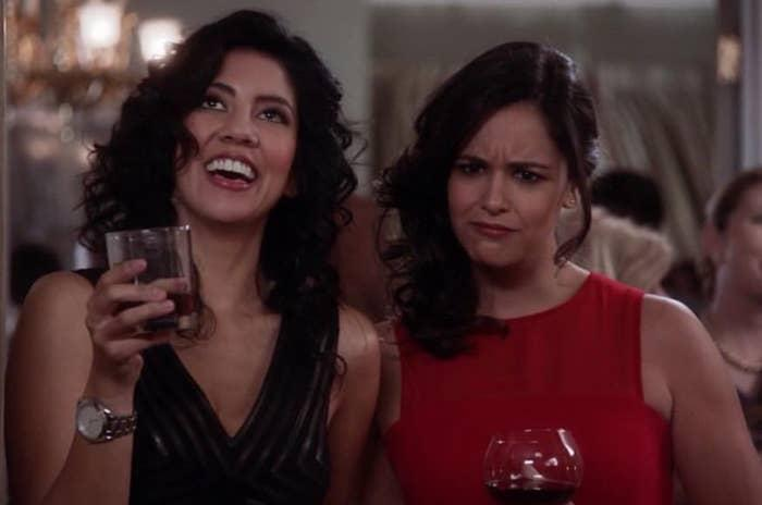 Rosa Diaz has her head thrown back as she laughs while Amy Santiago has her eyebrows furrowed in confusion
