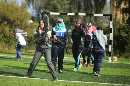 Palestinian women take part in a baseball training session in Khan Younis in the southern Gaza Strip March 19, 2017.  REUTERS/Mohammed Salem
