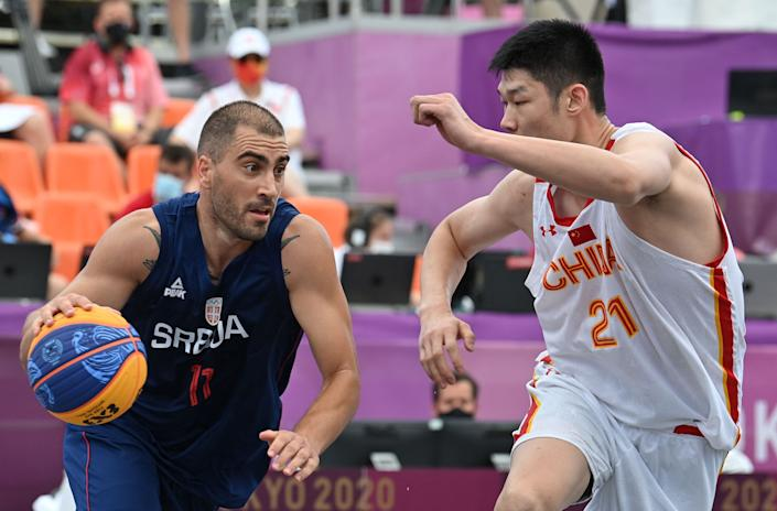 Serbia's Dusan Bulut (left) and other 3x3 basketball players may not be the same talent level as NBA players, but that doesn't mean the 5-on-5 pros would just walk in and dominate. (Photo by ANDREJ ISAKOVIC/AFP via Getty Images)