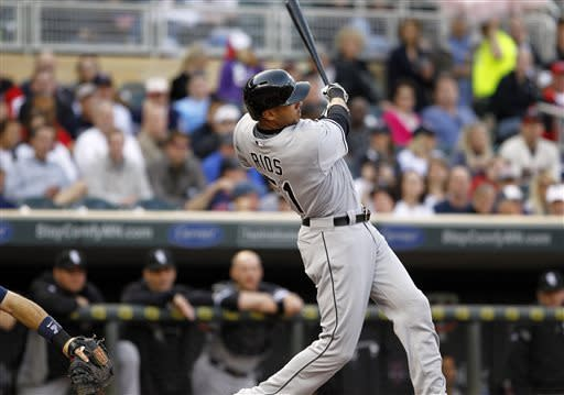 Chicago White Sox's Alex Rios hits an RBI double against Minnesota Twins starting pitcher Pedro Hernandez during the first inning of a baseball game, Monday, May 13, 2013, in Minneapolis. (AP Photo/Genevieve Ross)