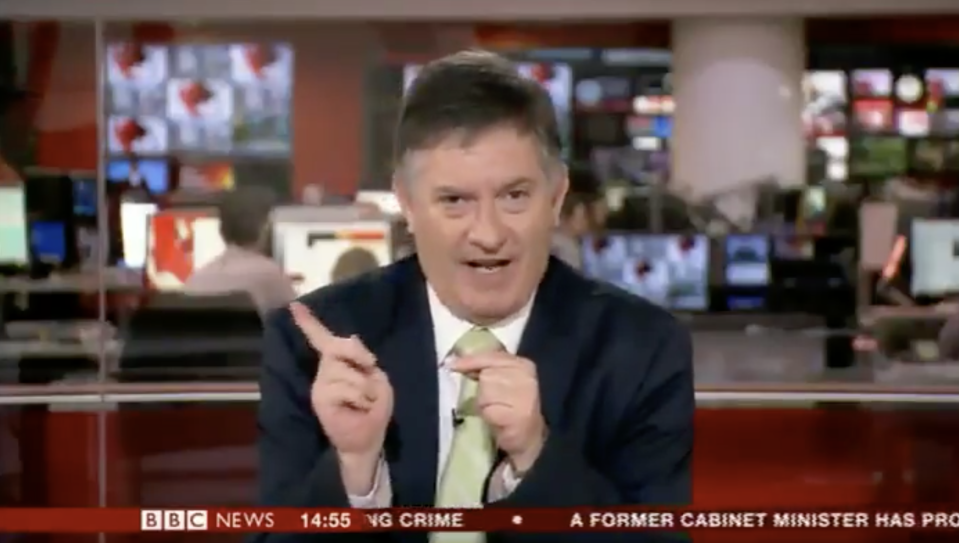 BBC News presenter Simon McCoy told the cameras to face the autocue so viewers could see the dog puns that had been written for him (BBC)