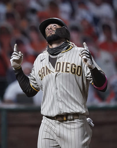San Diego Padres' Fernando Tatis Jr. points to the sky as he crosses home plate after hitting two-run home run against the San Francisco Giants during the third inning of the second game of a baseball doubleheader Friday, Sept. 25, 2020, in San Francisco. (AP Photo/Tony Avelar)