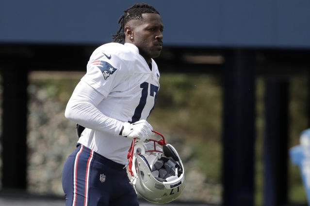 FILE - In this Wednesday, Sept. 18, 2019, file photo, New England Patriots wide receiver Antonio Brown carries his helmet during an NFL football practice in Foxborough, Mass. The Patriots released Brown on Friday, Sept. 20, 2019. (AP Photo/Steven Senne, File)