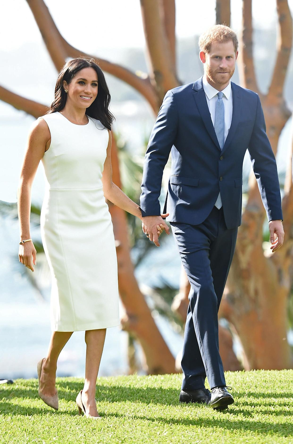 The duchess wears a white sheath dress by Karen Gee on Oct. 16, the first day of the royal tour.