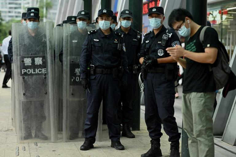 Policemen stood guard outside Evergrande's headquarters as anger grew over the housing giant's debt crisis mounted (AFP/Noel Celis)