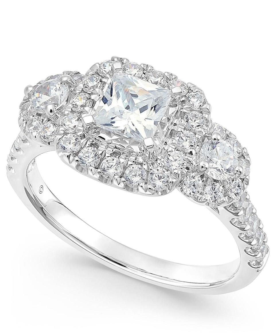 <p>You'll love the princess cut on this <span>Triple Cluster Engagement Ring</span> ($2,495, originally $5,700).</p>