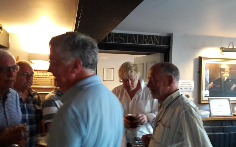 Sir Michael Fallon, foreground, and Boris Johnson in the pub in Kent on Saturday evening - Credit: Telegraph source/Telegraph source