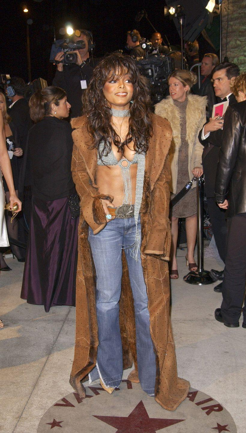 <p>Janet's look at the Vanity Fair Oscars party was all about layering, even if that meant stripping down to a bathing-suit top.</p>