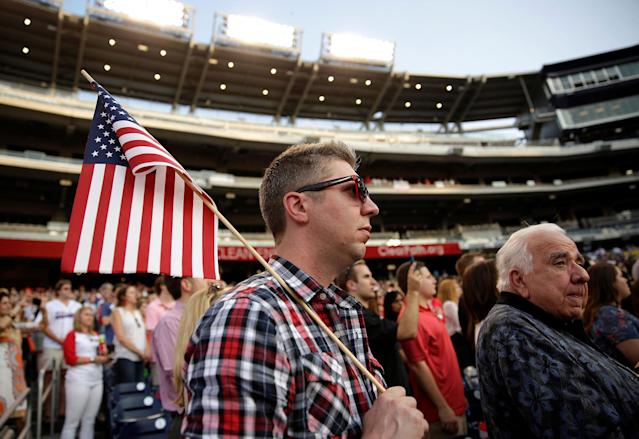 <p>A Republican supporter holds up an American flag before Democrats and Republicans face off in the annual Congressional Baseball game at Nationals Park in Washington, June 15, 2017. (Photo: Joshua Roberts/Reuters) </p>