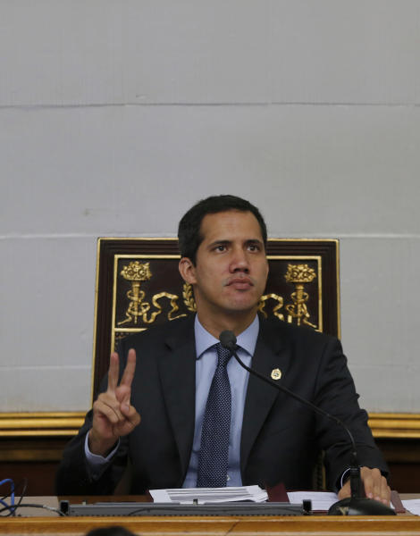 Juan Guaido, President of National Assembly and self-proclaimed interim president makes a victory sign during a session of the National Assembly in Caracas, Venezuela, Tuesday, April 2, 2019. Venezuela's chief justice on Monday asked lawmakers of the rival pro-government National Constituent Assembly to strip Guaido of his parliamentary immunity, taking a step toward prosecuting him for alleged crimes as he seeks to oust President Nicolas Maduro.(AP Photo/Fernando Llano)