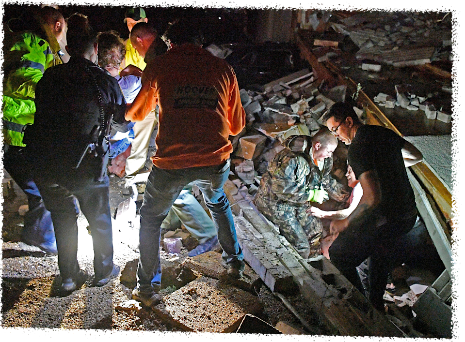 Bill Wallace gets help from rescue workers who freed him from his Barrett Drive home that collapsed on him and his wife Shirley trapping them under rubble.