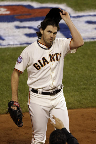 San Francisco Giants' Barry Zito tips is hat to the crowd after being removed from the game during the sixth inning of Game 1 of baseball's World Series against the Detroit Tigers Wednesday, Oct. 24, 2012, in San Francisco. (AP Photo/Jeff Chiu)