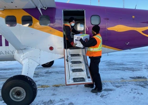 Doses of Moderna's COVID-19 vaccine are loaded onto a plane for delivery to Southend and Wollaston in Saskatchewan.