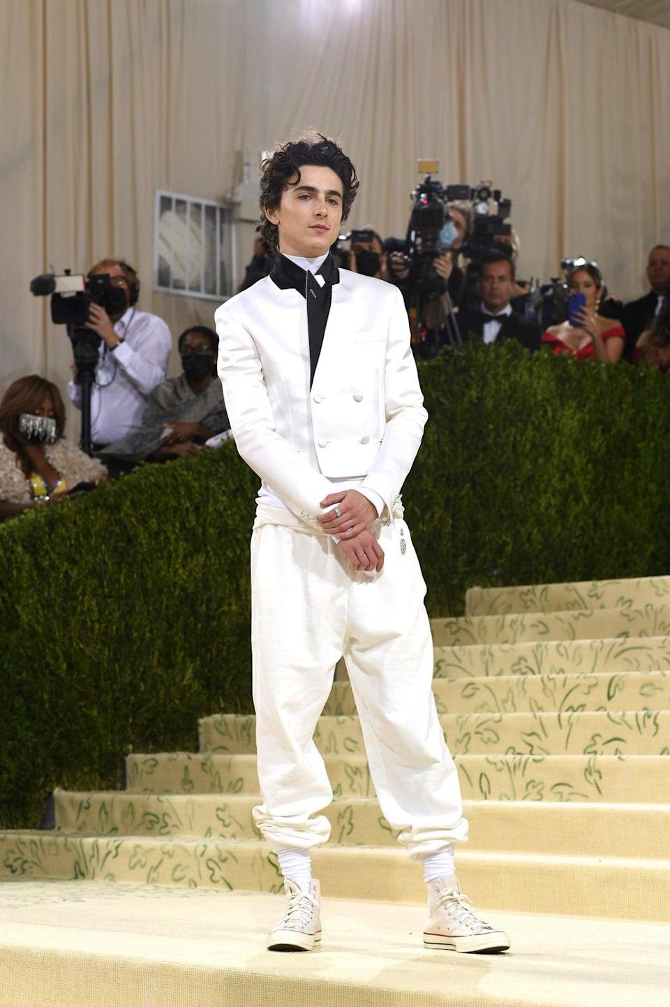 Timothee Chalamet opted for a casual look at the Met Gala, arriving in Converse trainers (Evan Agostini/Invision/AP) (AP)