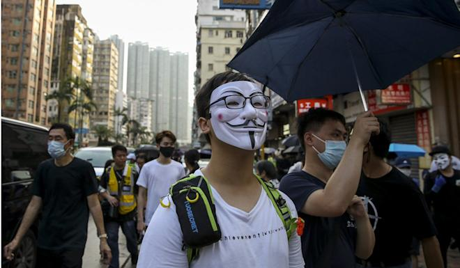 Protesters march through Tsim Sha Tsui on Saturday. Photo: Winson Wong