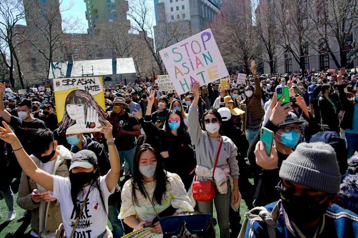 People take part in a rally against hate and the rising violence against Asians living in the U.S., at Columbus Park in the Chinatown section of the Manhattan borough of New York, on Sunday, March 21, 2021.