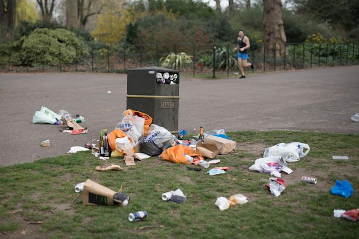 Bins overflow with rubbish in Battersea Park in south London after yesterday's record breaking warm weather. Picture date: Wednesday March 31, 2021. The UK may be about to experience its hottest March on record with temperatures forecast to soar to around 25C (77F).