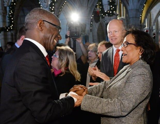 Quebec Liberal MP Emmanuel Dubourg, left, shakes hands with B.C. Liberal MP Hedy on Parliament Hill in Ottawa. A newly formed non-profit called Black Voters Matter Canada is trying to get more Black politicians to run for office, especially with the possibility of a federal election in the near future. (THE CANADIAN PRESS/Sean Kilpatrick - image credit)