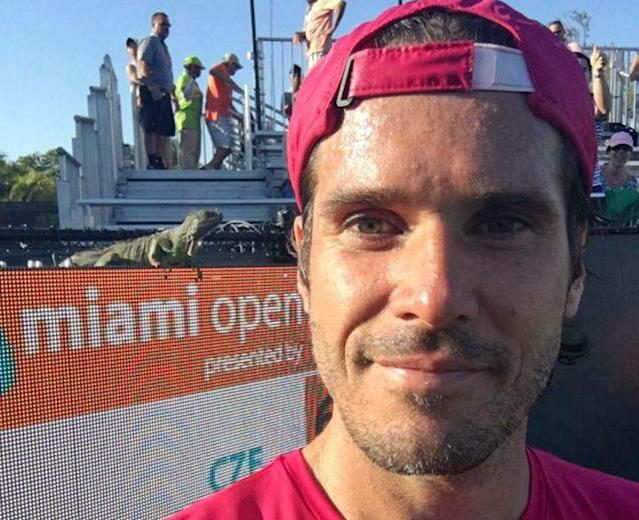 Tommy Haas took a selfie with an interested spectator at the Miami Open. (AP)